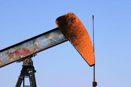 beam pump: Oil well pump showing walking beam horse head and polished rod Stock Photo
