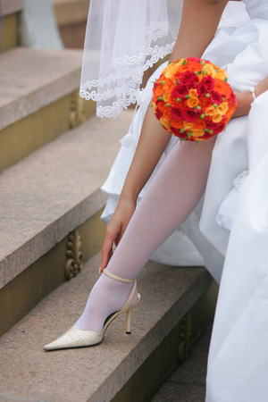 A close up portrait of a bride in a traditional white wedding dress. Stock Photo - 1599921