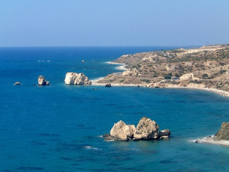 A general view of the bay where Aphrodites rock is situated, on the island of Cyprus. The bay is also known as Petra tou Romiou.  photo