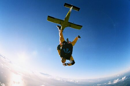 freefall: A skydiver parachuting from an aircraft