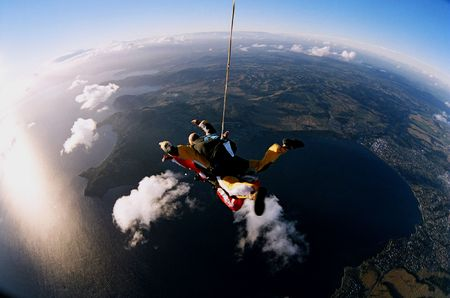 A tandem skydiver falling to earth