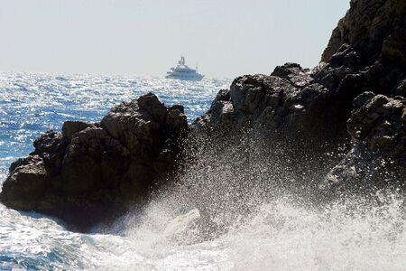 crashing: A portrait of some waves crashing on the rocky shore Stock Photo