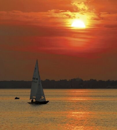 nile: A yacht sailing at sunset on the river Nile in Egypt