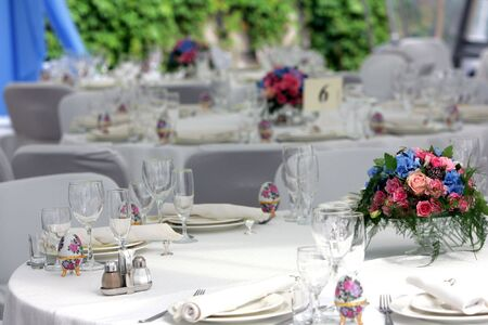 A general view of a table at a wedding reception. photo