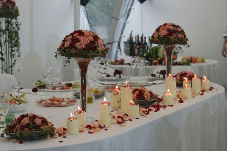 A general view of a room laid out for a wedding reception.  Banco de Imagens