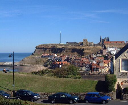 A general view of Whitby Abbey and Harbour viewed from the north side of Whitby Harbour in North Yorkshire, in England in the U.K.  photo