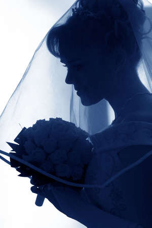 half body: Newly married bride holding bouquet in half body silhouette Stock Photo