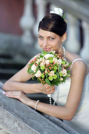 Portrait of a bride in a white wedding dress holding a bouquet Stock Photo - 1858558