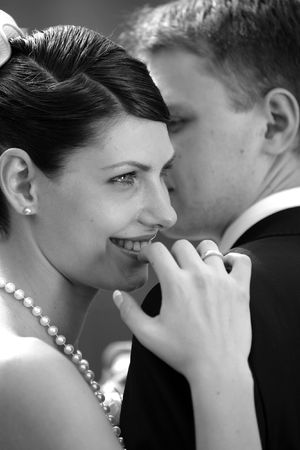 Newly Married bride smiling on her new husbands shoulder Stock Photo - 1858547