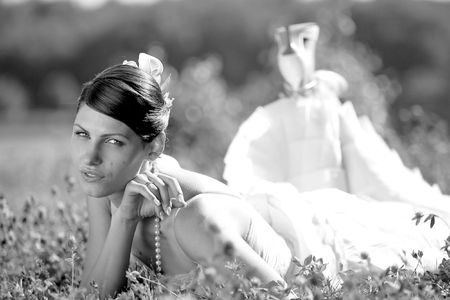 younglady: Newly married bride lying down in a field and smiling happily