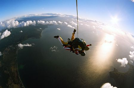Two people skydiving in tandem from an aeroplane. photo