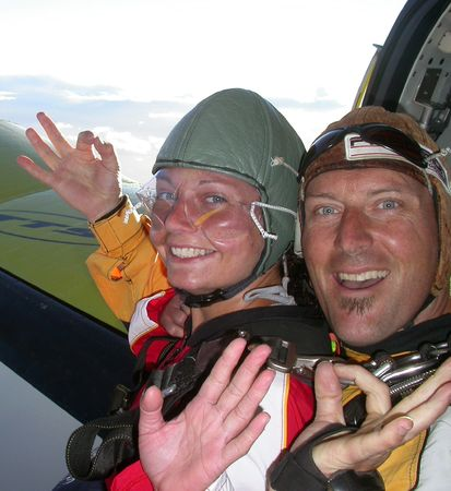 skydive: Two people pictured waving before they jump from an aeroplane in a skydive