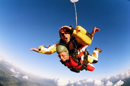 parachute jump: Two people skydiving in tandem from an aeroplane.