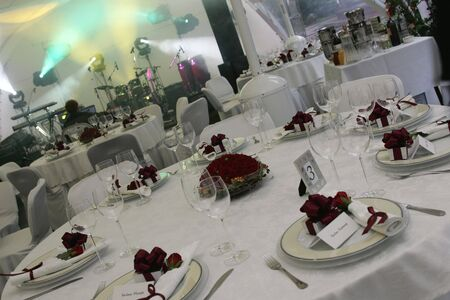 A general view of some laid tables at a wedding reception party.