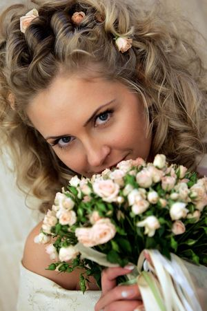 A portrait of a beautiful bride holding a bouquet of flowers. photo