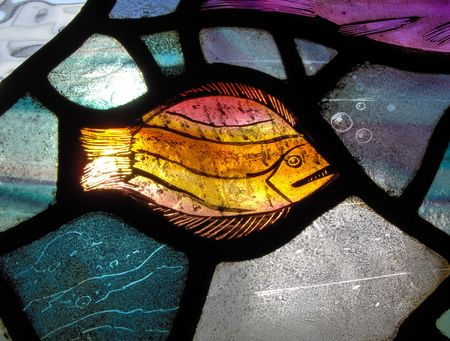 glasswear: A stained glass window in a church showing a fish