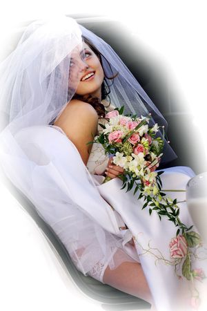 A beautiful bride getting out of her wedding car limousine holding a bouquet of flowers. Stock Photo - 2421080