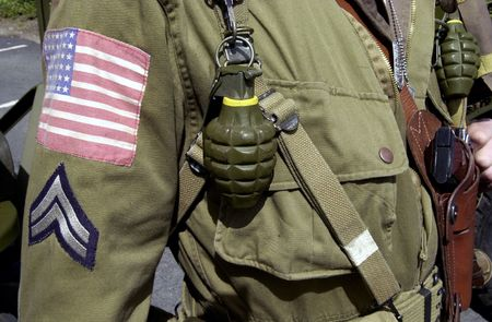corporal: A close up portrait of the uniform of an American Combat soldier from World War II.  Stock Photo