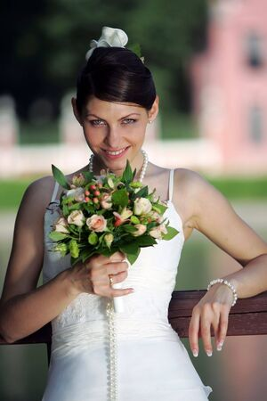 half body: A half body portrait of a beautiful bride holding a bouquet of flowers in her hand Stock Photo
