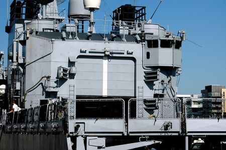 superpowers: A general view of a modern naval warship seen here from behind. This is a naval destroyer ship, belonging to one of the modern military superpowers. Stock Photo