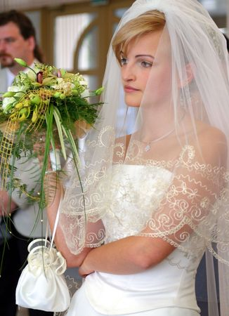 Beautiful bride in traditional wedding dress holding bouquet Stock Photo - 2528295