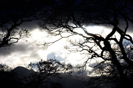 shadowy: A dramatic night sky seen here in the lake district in Cumbria in the UK. Stock Photo