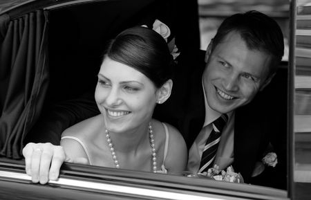 Bride and groom in black wedding car limousine Stock Photo - 2580550