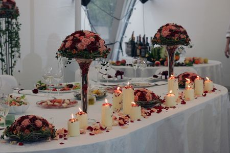 Beautifully decorated place settings on head table at wedding reception