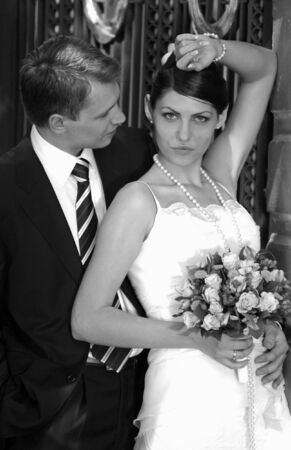 Bride and groom newlyweds seen here on their wedding day, Bride is wering a traditional white wedding dress Stock Photo - 2678579