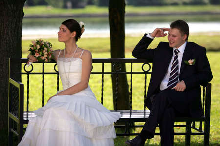 Bride and groom newlyweds seen here on their wedding day, Bride is wering a traditional white wedding dress photo