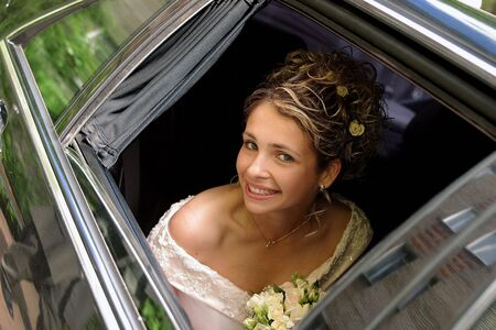 Smiling beautiful bride in traditional white weddiing dress  photo