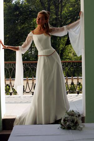 Smiling beautiful bride in traditional white weddiing dress  Stock Photo - 2733338
