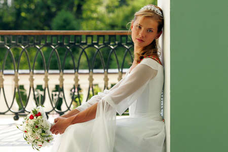 Smiling beautiful bride in traditional white weddiing dress  Stock Photo - 2733340