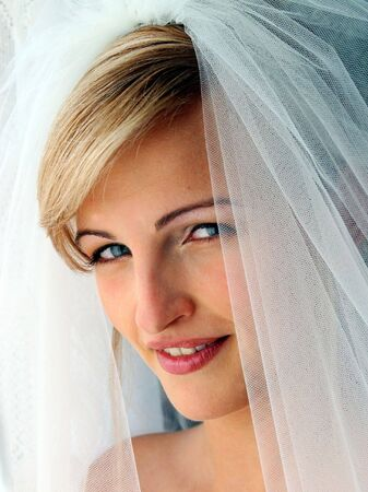 Smiling beautiful bride in traditional white weddiing dress  Stock Photo - 2733432