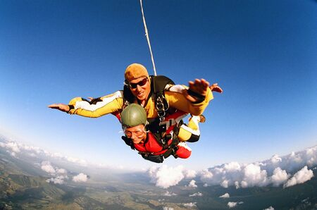 thrilling: Man and woman skydiving in tandem from an aircraft