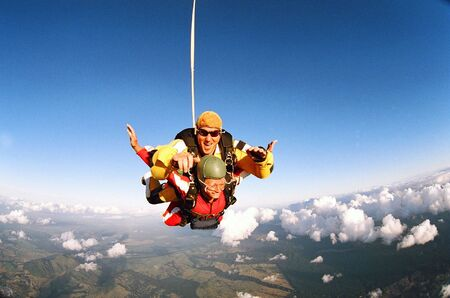 Man and woman skydiving in tandem from an aircraft Stock Photo - 2786042