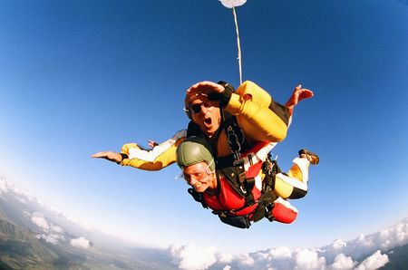 parachuting: Man and woman skydiving in tandem from an aircraft