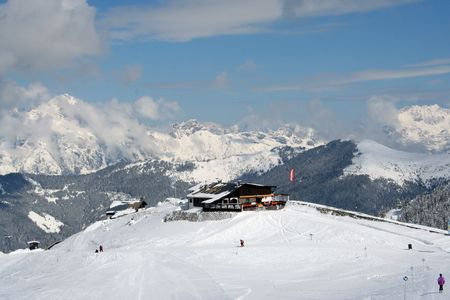 seaonal: Skiers on the slopes of the Austrian Alps mountains near to resort of Zell am Zee. Stock Photo