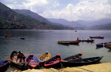 phewa: A scenic view of country of Nepal showing boats moored on Phewa Lake. Stock Photo