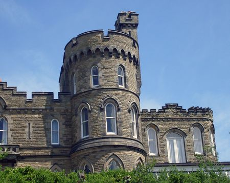 battlements: Historic house sahped like a castle with battlements and turrets.