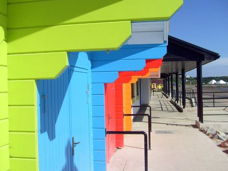 Exteriors of beautiful bright seaside beach chalets, Scarborough, England. Stock Photo - 3257873