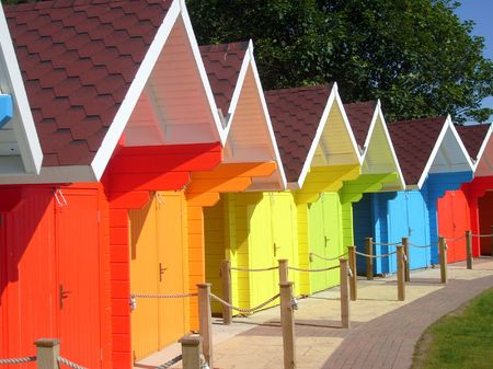Exteriors of beautiful bright seaside beach chalets, Scarborough, England. Stock Photo