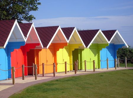 architectural exterior: Exteriors of beautiful bright seaside beach chalets, Scarborough, England. Stock Photo