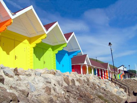 Colorful beach chalets by seaside, Scarborough North Bay, England, U.K.