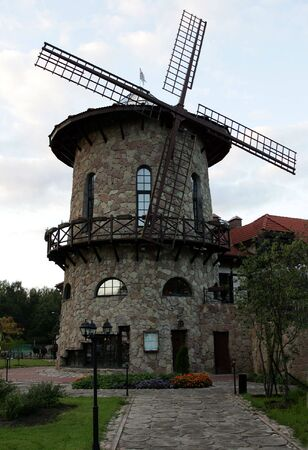 wind powered building: Exterior of Dutch windmill pictured near to Amsterdam.