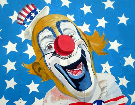 Painting of smiling patriotic American clown surrounded by stars. photo