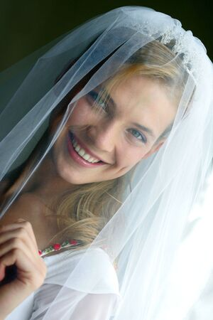 Portrait of beautiful bride in traditional white wedding dress smiling. Stock Photo - 3546505
