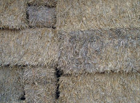 stacked up: Close up of some bales of hay on farm. Stock Photo