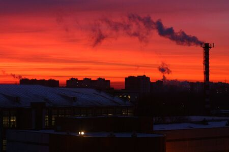 polluting: Smoking chimneys from factories polluting the environment Stock Photo
