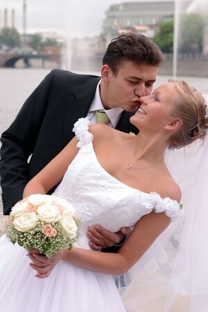 Beautiful bride in white with handsome groom on wedding day photo